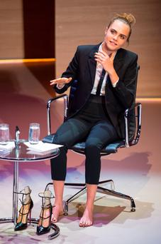 Cara Delevingne's narrow-legged choice with Charles Loubutin's 'Toerless' shoes at the Women in World conference.