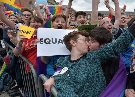 A gay couple kiss in Dublin Castle Square as the result of the referendum is relayed on May 23, 2015 in Dublin