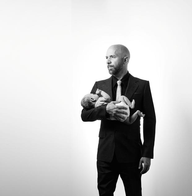 New man: Neil Strauss and his infant son Tenn.