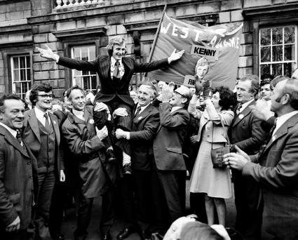 Supporters carry a young Enda outside Leinster House on his first day in the Dáil, in 1975.