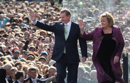 Wing woman: Enda and Fionnuala arrive onstage at College Green before US President Barack Obama speaks on May 23, 2011.
