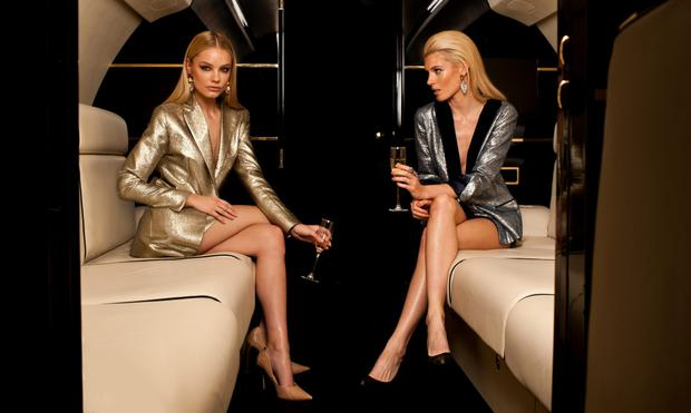 Holly, left, wears: Jacket, €400; matching skirt, €220; earrings, €95. Shoes, model's own; Katherine, right, wears: Jacket with velvet lapels and satin trim, €395; matching skirt, €220; earrings, €95; rings, €99 each. Shoes, model's own