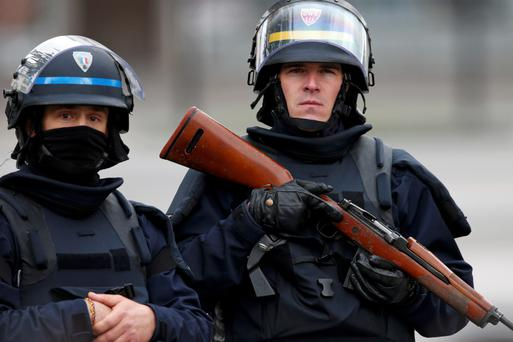 Alert: Police in Saint-Denis, near Paris. Reuters.