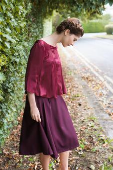 Silk-satin top, €259; silk-lined, wool-crepe skirt, €289, both Unicorn by Sophie Rieu. Photo: Patrick McHugh.