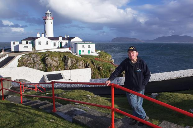 Safe hands: Eamon McAteer (main) who lives and works at the Fanad lighthouse in Donegal.