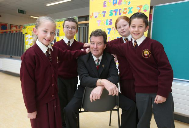 Time for change: Seán Ó Díomasaigh, school principal, at, Sacred Heart of Jesus NS, Huntstown, with pupils (from left): Emma Greaves (10), Ben Talbot (9), Amy Devoy (9), and Shaun Doyle (10). Photo: Damien Eagers