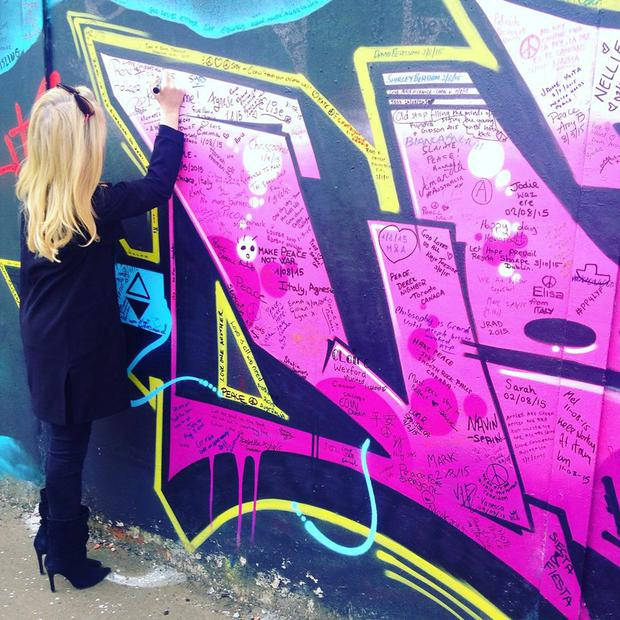 Soak up the atmosphere and write on a peace wall like reporter Niamh