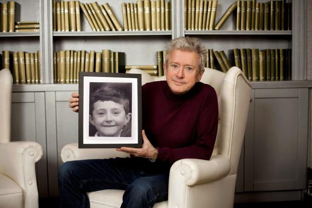 Louis Walsh with a picture of his younger self. Photo: Naomi Gaffey.