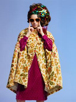 1970s tapestry cape, €160; 1970s velvet dress, €140, both Miss Daisy Blue. Craft pompoms (in hair), €1.99; coloured wool (in hair), €2.50, both Vibes & Scribes. Vintage sunglasses, €46, Miss Daisy Blue.
