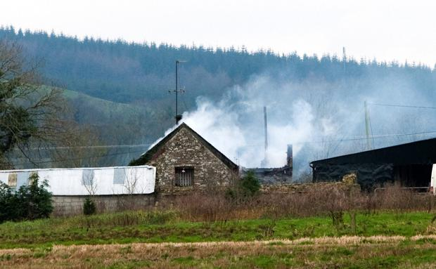 The scene of the house fire at Seskin near Windgap county Kilkenny where Sharon and her daughters Zarah and Nadia lost their lives.