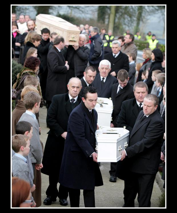 Tragic: The remains of Sharon Whelan and her two daughters are carried to their funeral Mass.
