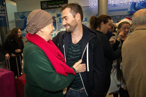 Stephen Harding is welcomed home from Los Angeles by his mother Pat Harding who is having treatment for cancer at Dublin Airport yesterday. Photo: Tony Gavin