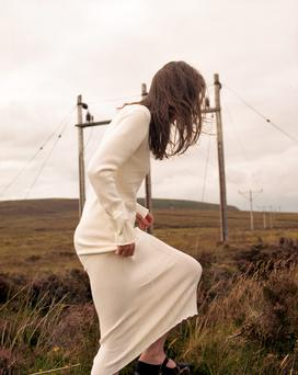 Merino-wool and Lurex knit dress, €895, Honor Fitzsimons. Origami cuff, €98, Capulet & Montague. Shoes, model's own.