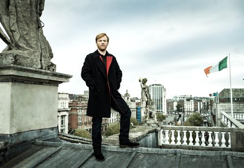 High life: Brian Gleeson on the roof of Dublin's General Post Office. Photo: Mark Nixon.