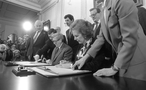 An Taoiseach Dr Garret Fitzgerald and British Prime Minister Margaret Thatcher siging the Anglo-Irish Agreement on November 15 1985. Photo: Matt Walsh