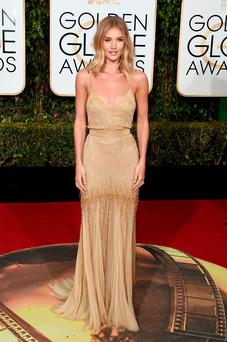 Actress Rosie Huntington-Whiteley attends the 73rd Annual Golden Globe Awards. Photo by Jason Merritt/Getty Images