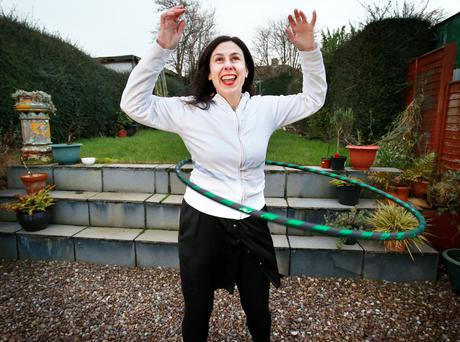 Forever young: Tara Gleeson (45) hula-hoops in her back garden. Photo: Frank McGrath