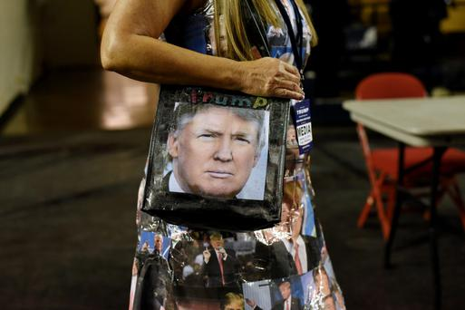 It's in the bag: a Trump supporter attends a 'Trump for President' rally.