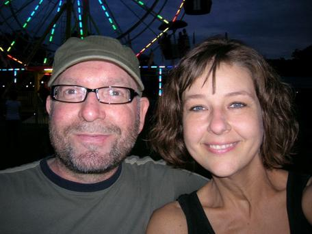 Hope: John and his wife Tracy who underwent chemotherapy for stage 3 breast cancer in the US at the same time as him