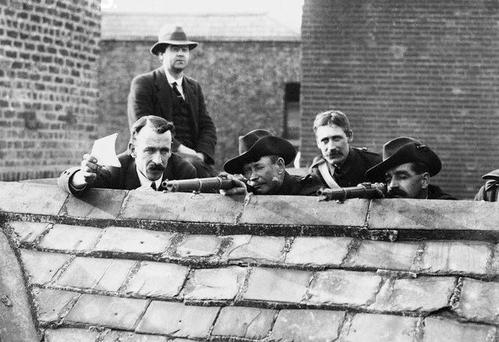 Gun battle: Irish Citizen Army snipers on a rooftop.