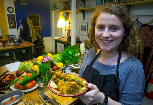 Batter up: Meadhbh McGrath tests her culinary skills at Silk Road Kitchen. Photo: Arthur Carron n