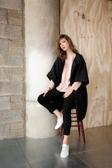 Bubble-textured coat (available from March), €189; panel blouse, €79; cigarette trousers, €89; leather trainers, €89.