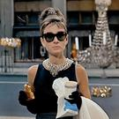 Caffeine kick: Holly Golightly, played by Audrey Hepburn, in 1961's 'Breakfast at Tiffany's', has her pastry and coffee outside Tiffany's jewellery store.