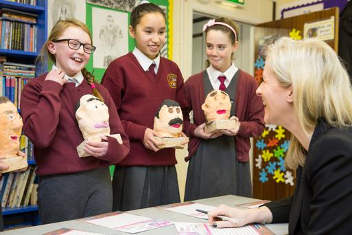 Eve Ni Dhonnaile, Siobhán Ni Ghliasáin and Dearbhla Ní Chatháin from 5th class in Gaelscoil na Camóige, Clondalkin, pitch their product in the BizWorld Dragons' Den Photo: Naoise Culhane.