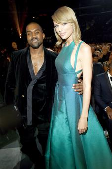 Kanye West and Taylor Swift in happier times at the 57th Grammy Awards in 2015.