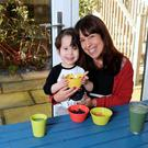 Informed: Glauce Lucas and her four-year-old son Enrico enjoy some vegan snacks at home. Photo: Caroline Quinn