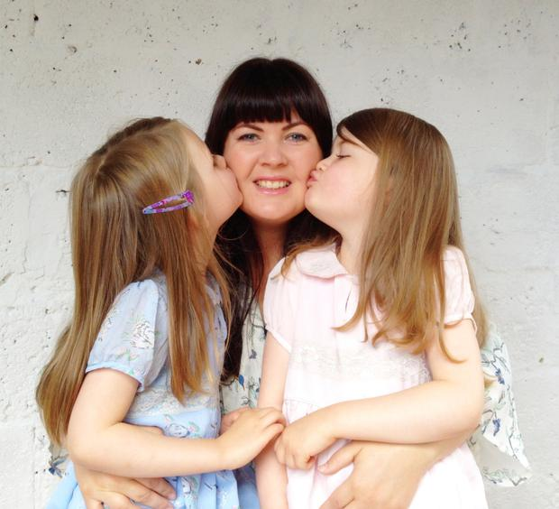 Happy: Sadhbh Devlin with her twin girls Sábha and Lile (5) who is she's raising gender neutral.