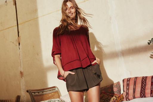 Smock blouse with cutwork, €13; shorts, €5.