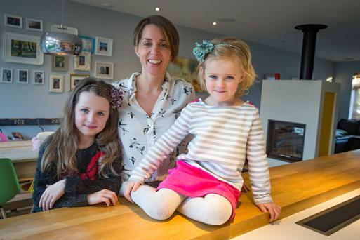 Lifestyle change: Siobhan Berry is rethinking her child-minding options for daughters Ashleigh (7) and and Jessica (4). Photo: Arthur Carron