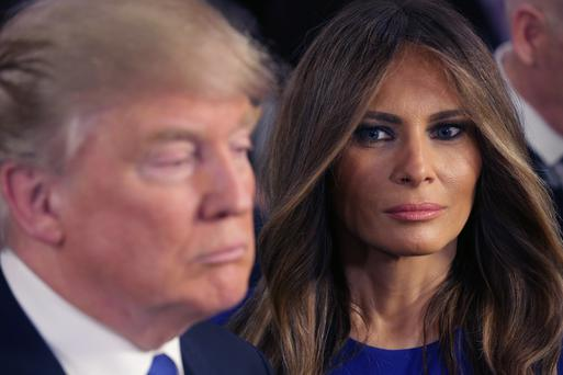 Behind every great man: Trump and wife Melania.