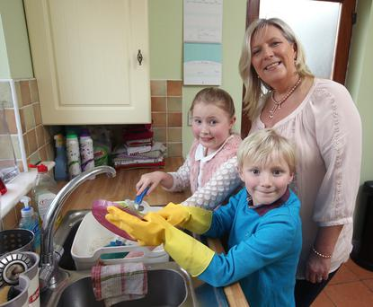 Everybody do their share: Ann Murphy with her children, Abby, 9, and Sean, 7, who help out with chores in the family home. Photo: Damien Eagers.