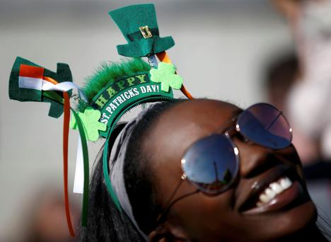 Party: A woman joins in the celebrations during a St. Patrick's Day party in Trafalgar Square, London. REUTERS/Peter Nicholls
