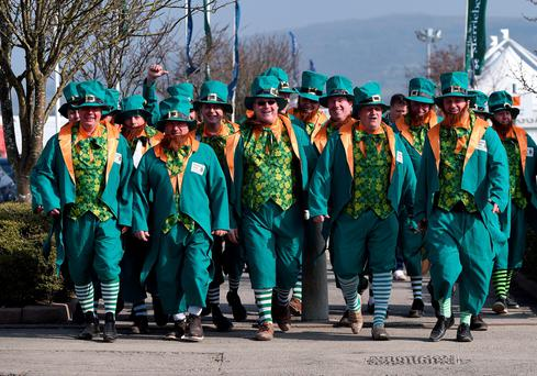 Luck of the Irish: Racegoers in fancy dress channel their inner leprechaun at Cheltenham this week.