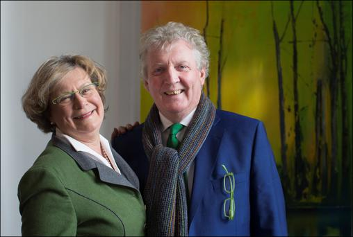 Mary and Martin Tritschler at the Origin Gallery in front of her canvas 'Annaghmakerrig'. Photo: David Conachy.