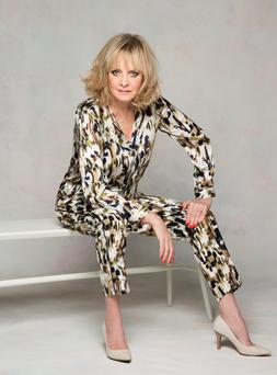 Twiggy wears ikat printed shirt, €47.50 and matching trousers, €47.50, nude pump, €74.