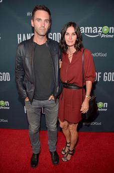 Snow Patrol guitarist Johnny McDaid with Courtney Cox.