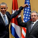 Grip and grin: Barack Obama with Raul Castro during the US President's visit to Cuba this week.