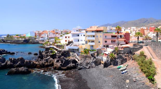The small village of Alcala, with its beach of black sands. The dormant volcano of MountTeide gives the island its black cragginess.