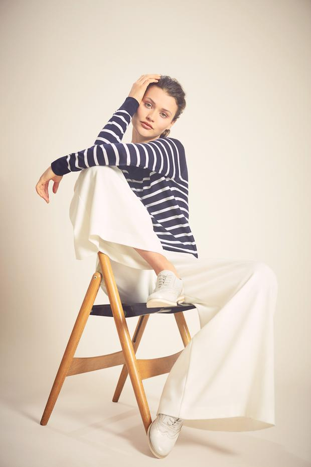 Navy thin stripe crew jumper, €55; cream 'Lia' long culottes, €175, also available in blush.