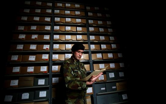 Officer in charge of military archives Commandant Padraic Kennedy studies files in the reading room at Cathal Brugha Barracks in Dublin.
