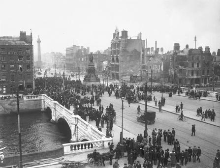 Rising rubble: Dubliners crossing O'Connell Bridge in the wake of the rebellion.