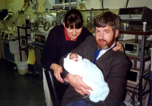 Elle's parents Noeleen and Trevor, holding their three-week old daughter for the first time, after she was born prematurely.