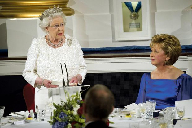 Queen Elizabeth delivering her speech, watched by Mary McAleese during the State dinner at Dublin Castle.