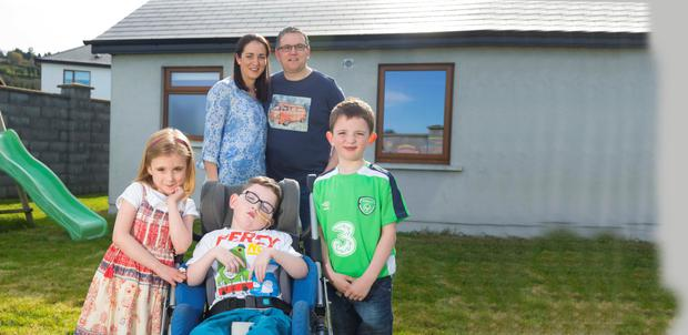 Michelle and Michael Russell from Carrick on Suir, Co. Tipperary with their children, triplets, Ruth, Cillian and Conor who are 5 years old. Photo: Patrick Browne