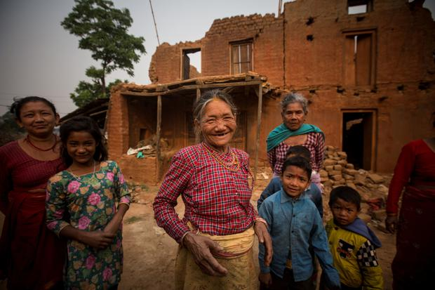 A woman outside her earthquake-damaged house in the Nuwakot region. Photo: Mark Condren