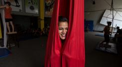 A performer with Circus Kathmandu relaxes during a practise session. Photo: Mark Condren